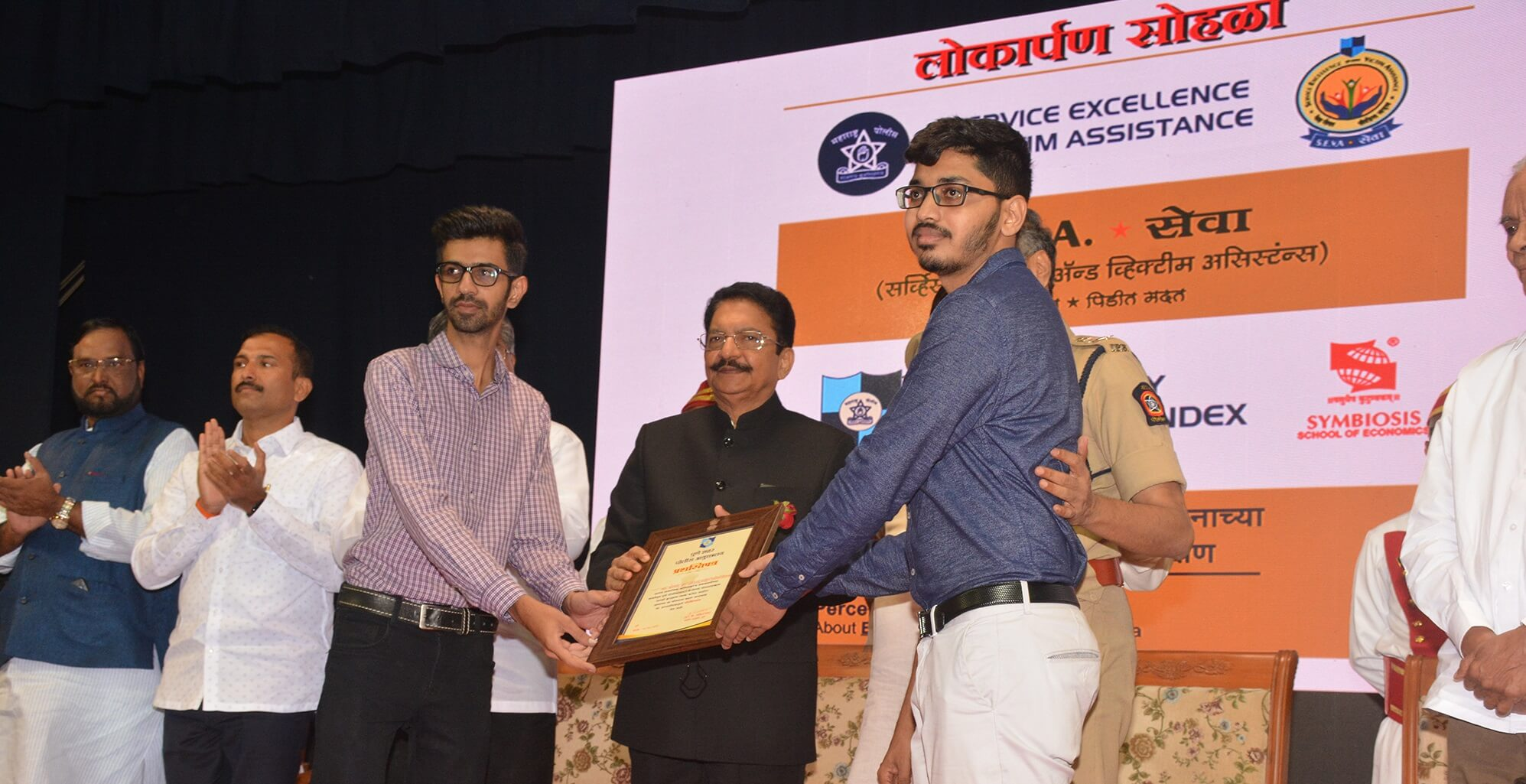 Adivid Technologies receiving award from Governor